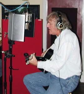 Jimmy McNally of the Instagators recording with an SE Reflexion Filter